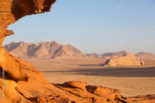 Fotobehang Oranje eclat A rock formation during sunset in Wadi Rum, Jordan