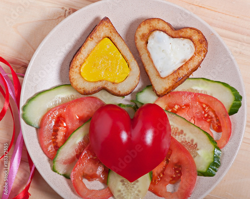 French fries and vegetables cut into the heart. Valentine's Day