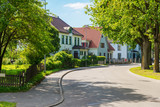beautiful street with modern residential houses in summer sunny - 183374163