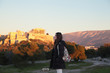 Young girl near fair sunset acropolis.Student in Athens,Greece.