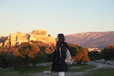 Young girl near fair sunset acropolis.Student in Athens,Greece. - 183374514