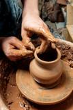 Potter at work. Workshop place. - 183380535