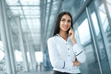 Business Woman Using Phone In Office