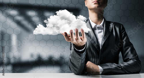 Woman presenting cloud in her hand.