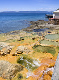 Natural hot spring baths of the Greek spa resort on the Aegean Sea - 183387371