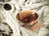 Warm knit sweater, a Cup of hot tea with chocolate and winter decorations - 183388577