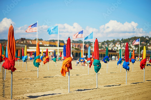 Many colorful umbrellas on the beach of Deauville
