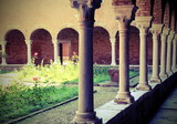 colonnade of a medieval cloister of an ancient convent - 183391799