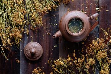 clay teapot of herbal therapeutic green tea © Kiryl Lis