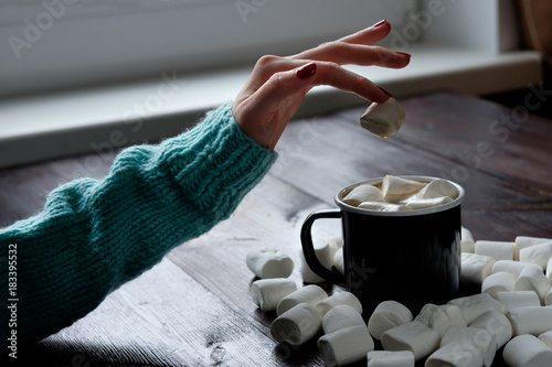 Sticker black cup of coffee with marshmallows