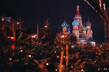 St Basil Cathedral in Moscow, Russia at night. Christmas trees on foreground
