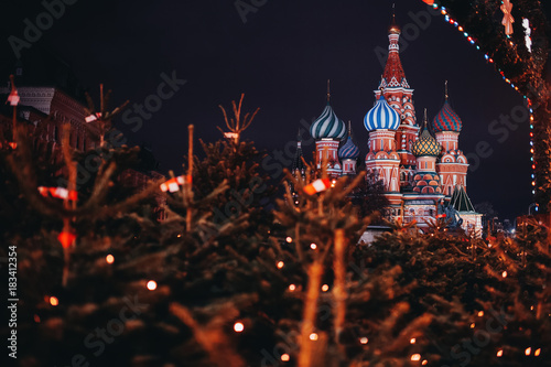 Foto op Canvas Moskou St Basil Cathedral in Moscow, Russia at night. Christmas trees on foreground