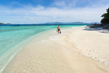 Man with snorkeling mask and flippers walking on the beautiful beach. - 183422996