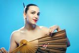 woman with fan - 183423781