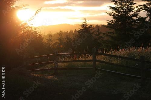 Plexiglas Chocoladebruin Sunset on the coast mountain range