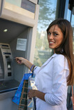 Business woman on ATM. - 183444975