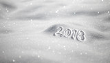 Happy New Year 2018 celebration message handwritten on the shiny sunny fresh morning snow. Selective focus used. - 183452941