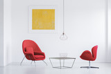 Red armchairs at designer table - 183461399