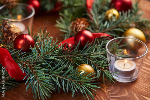 Foto op Canvas Natuur christmas wreath with red and golden balls