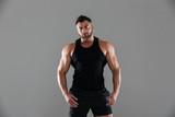 Portrait of a confident serious male bodybuilder - 183463982