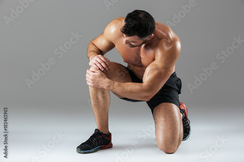 Portrait of a strong muscular male bodybuilder