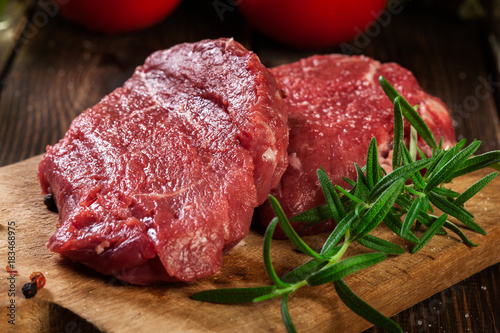 Foto op Canvas Steakhouse Fresh raw beef steak sirloin with rosemary