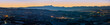 Wide angle panoramic view of Langhe Region in winter during blue hour, italy
