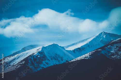 Fotobehang Blauwe jeans Mountain snow peak, beautiful natural winter backdrop. Ice top of the hill, blue sky background. Alpine landscape.
