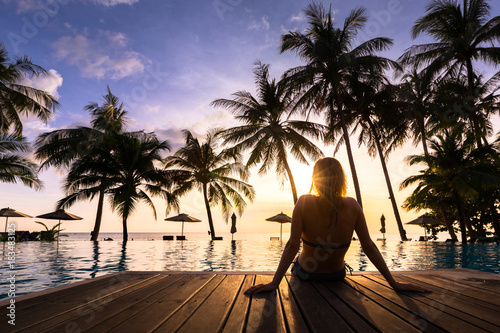 Woman enjoying vacation holidays luxurious beachfront hotel resort swimming pool