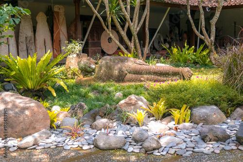 Papiers peints Buddha sculpture of buddha lying in grass in bali. indonesia.