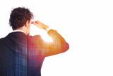Businessman looks far for the future - 183488105