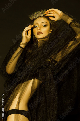 A beautiful, sensual girl, model in a glamorous, fashionable image posing in a photo studio with color filters. Fashion, style, beauty, portrait.