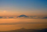Aerial view of Japan's Mount Fuji volcano at sunset in the clouds