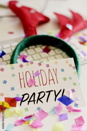signboard with text holiday party on office desk