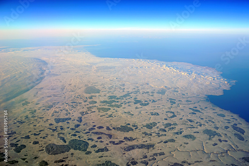 Papiers peints Gris Aerial view of ice and snow on St Lawrence Island in the Bering Sea in Alaska