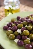 Marinated olives in plate - 183499362