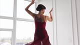 Graceful woman dancer having a training in the ballroom. Passionate performance - 183501155