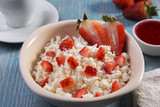 cottage cheese grainy crumbly with pieces of strawberries jam and coffee breakfast - 183502375