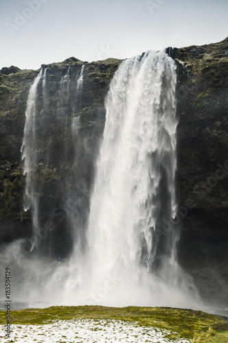Vertical landscape of Seljalandfoss waterfall - 183504129