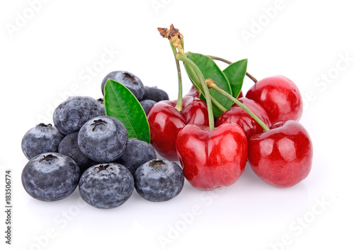 Fotobehang Kersen Cherry and blueberries isolated on a white background