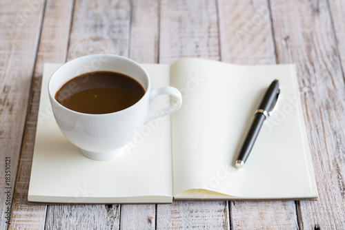 Fototapeta Coffee cup on a wooden table background