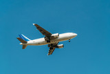 Passenger Airplane Flying On Clear Blue Sky