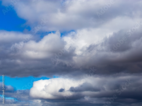 rain clouds on a blue sky as a background