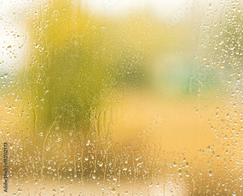 drops of rain on the window as a background