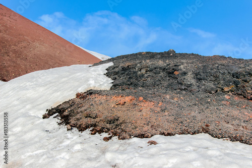 Staande foto Cappuccino snow on lava stone on mountain etna