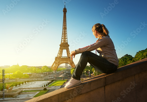 girl looking at the Eiffel tower in sunrise time, Paris Poster