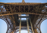 Detail bottom view of  Eiffel Tower on the blue sky background - 183519177