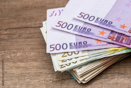 Poster 100, 200 and 500 euro banknotes on desk