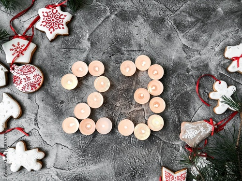 Tuinposter Brandhout textuur Date in calendar. December day. Christmas is coming. Advent. New Year and Christmas background. Number from candle light. Homemade Christmas cookies. 31 of December