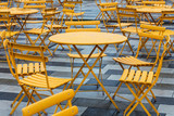 tables and chairs in a cafe on street - 183521982